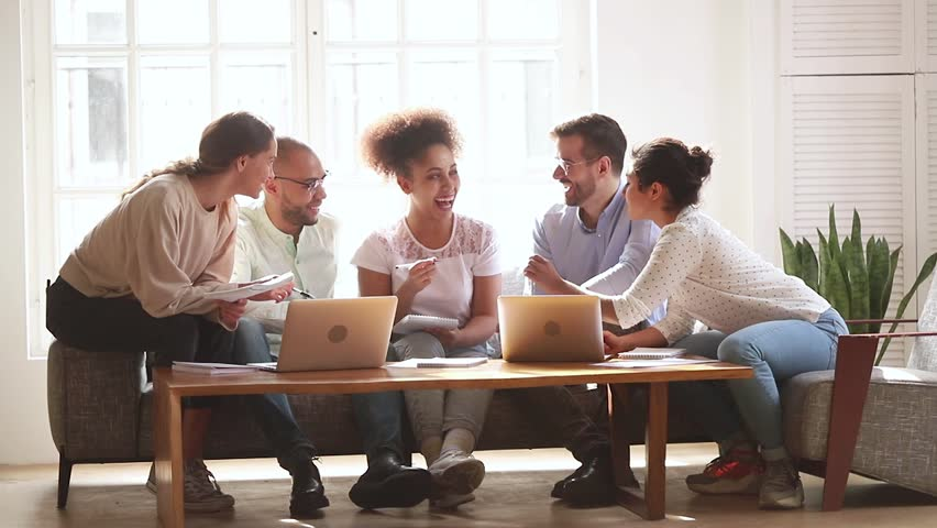 Happy diverse friends team studying together with laptop and notebooks prepare for exam in dormitory, multicultural young students people group talking laughing helping do creative research project Royalty-Free Stock Footage #1028900342