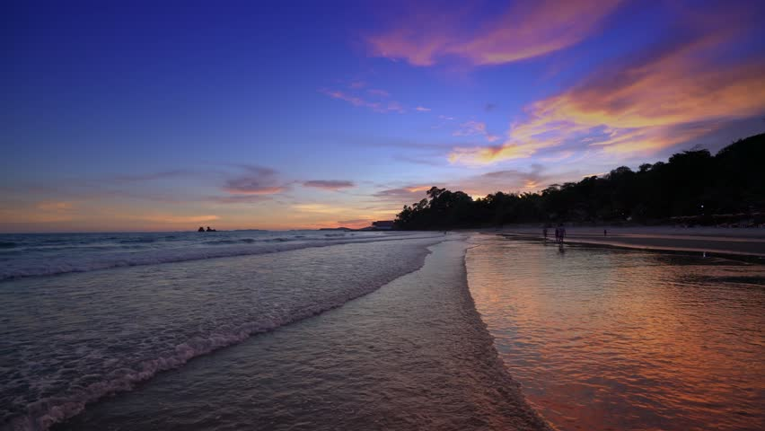 Colorful sunset over the beach in the tropical beach sea, The tropical paradise beach of Thailand