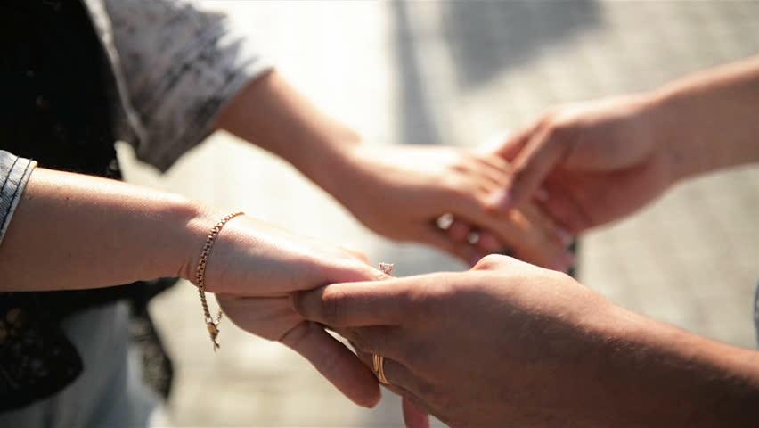 Close Up Of Couple Holding Hands Walking Along City Street. | Shutterstock HD Video #1028923715
