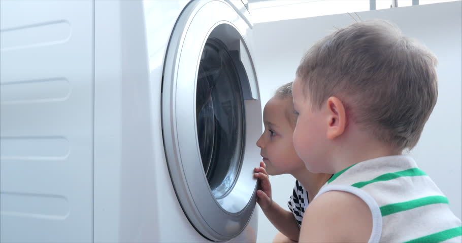 Cute Children Looks Inside the Washing Machine. Cylinder Spinning Machine. Concept Laundry Washing Machine, Industry Laundry Service. | Shutterstock HD Video #1028924585