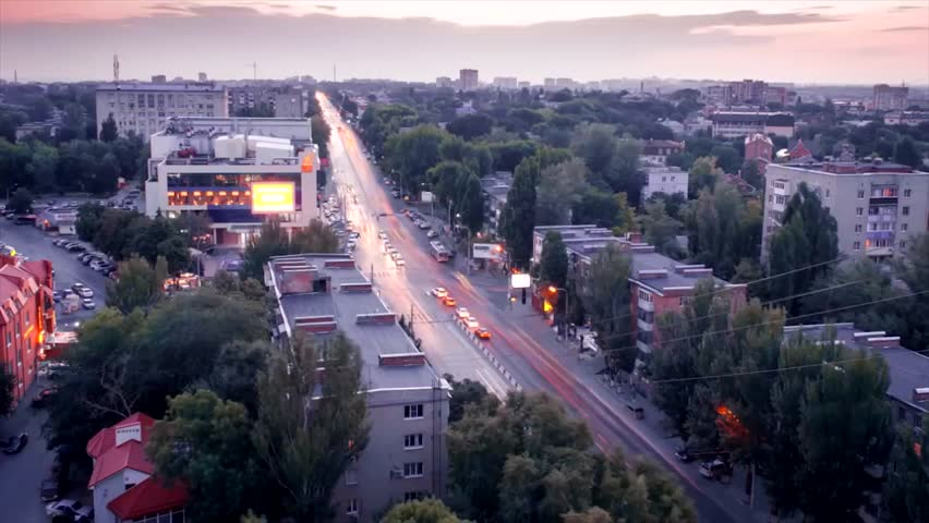 Time lapse. A beautiful view from a high-rise building when the sun sets. Fast traffic from cars #1028926817