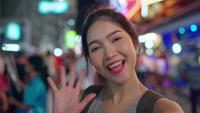 Traveler Asian blogger woman travel in Bangkok, Thailand, beautiful female using mobile phone make vlog and live in social media while hangout at The Khao San Road. Women travel in Thailand concept.