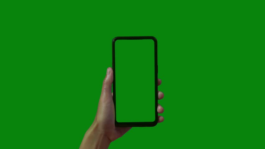 Phone in the hand close up isolated at green background. Phone screen is blue chroma key, background chroma key green screen. Footage for mobile ads, app promo.