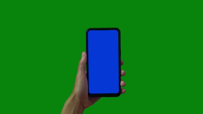 Phone in the hand close up isolated at green background. Phone screen is blue chroma key, background chroma key green screen. Footage for mobile ads, app promo. | Shutterstock HD Video #1028986922
