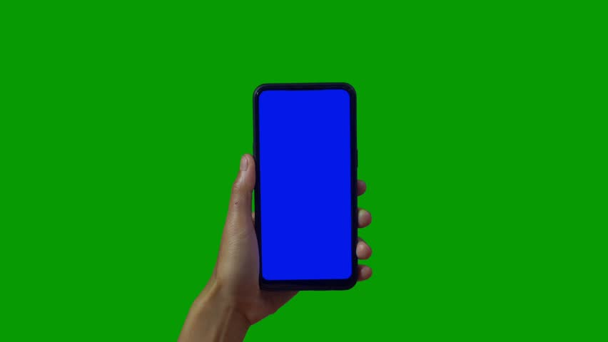 Phone in the hand close up isolated at green background. Phone screen is blue chroma key, background chroma key green screen. Footage for mobile ads, app promo. | Shutterstock HD Video #1028986931