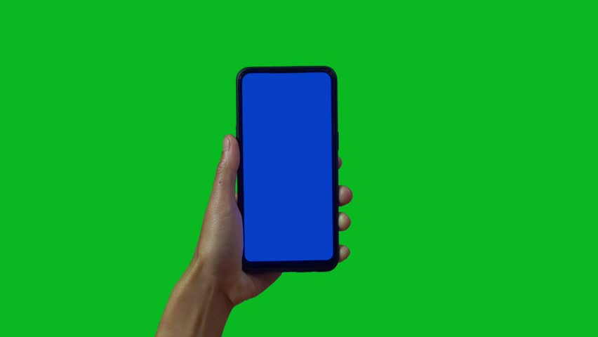 Phone in the hand close up isolated at green background. Phone screen is blue chroma key, background chroma key green screen. Footage for mobile ads, app promo. | Shutterstock HD Video #1028986940