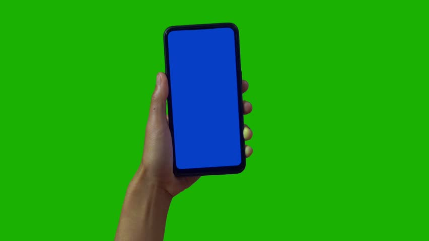 Phone in the hand close up isolated at green background. Phone screen is blue chroma key, background chroma key green screen. Footage for mobile ads, app promo. | Shutterstock HD Video #1028986946