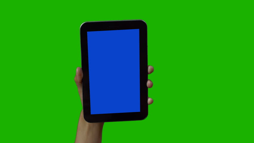 Tablet in the hand close up isolated at green background. Phone screen is blue chroma key, background chroma key green screen. Footage for mobile ads, app promo. | Shutterstock HD Video #1028988125