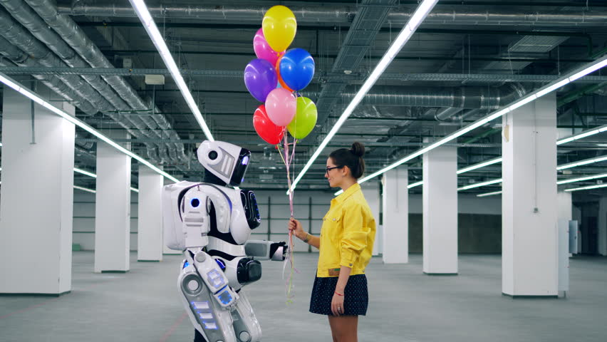 A girl and a robot are holding balloons together | Shutterstock HD Video #1028988533