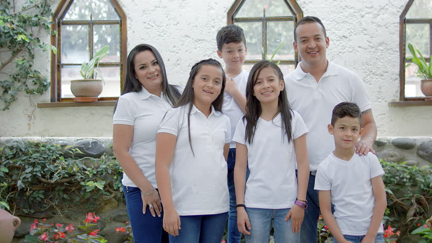 Hispanic family wearing white at home