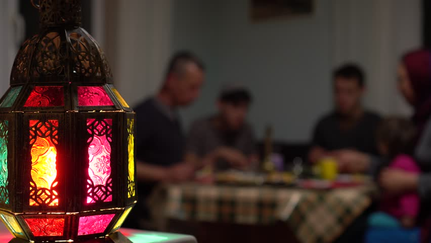 The Muslim family, husband, wife and children. During Iftar it is usual to cook multiple dishes for break fast. Eid, salam, Quran, Mubarak, family prayers | Shutterstock HD Video #1028995553
