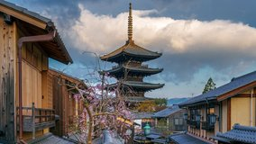Time lapse of Yasaka Pagoda and Sannen Zaka Street with cherry blossom in Kyoto, Japan.