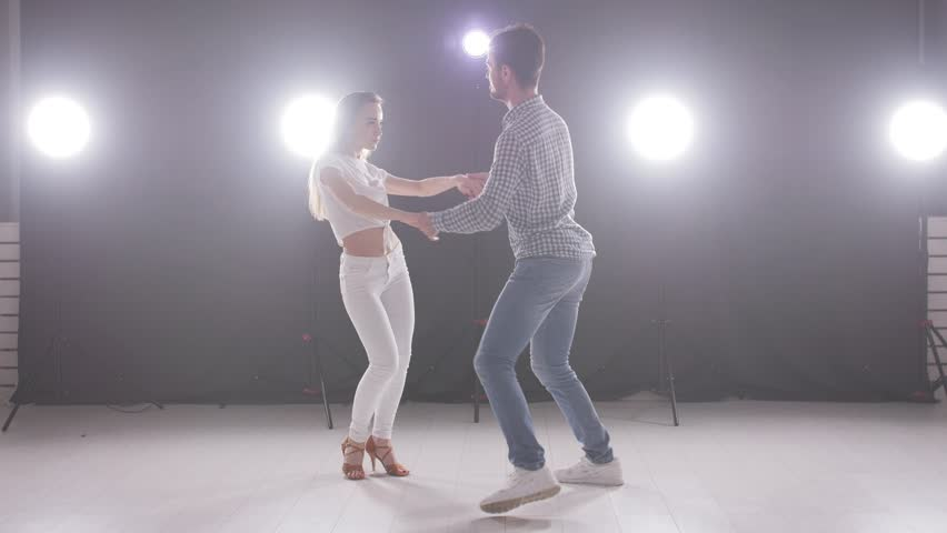 Concept of social dance and relationships. Young beautiful couple dancing sensual dance bachata.