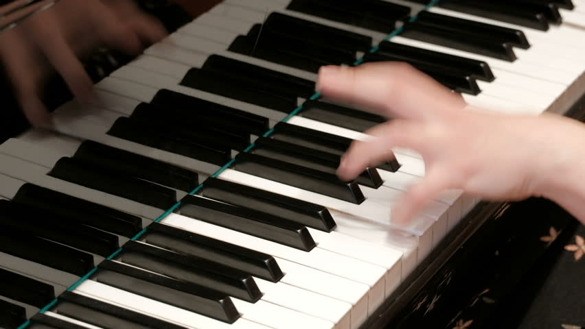 Piano playing. Close-up. Musical theme. Concert program. Female hands press piano keys. | Shutterstock HD Video #1029050978