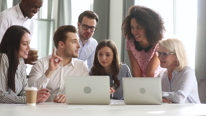 Male caucasian mentor teacher training business team interns workers gather discuss online project in teamwork, employees group listen manager talk explain computer work at corporate office meeting Royalty-Free Stock Footage #1029051446