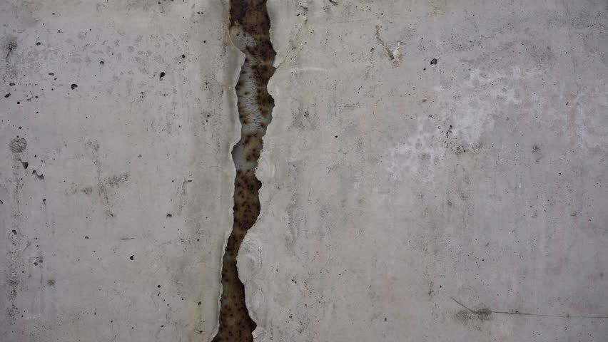 4K. Concrete real dirty wall. Seamless texture. Grunge grey background pattern. Cement and sand cracked wall of tone vintage for backdrop or decoration. Graffiti wall.  | Shutterstock HD Video #1029052694