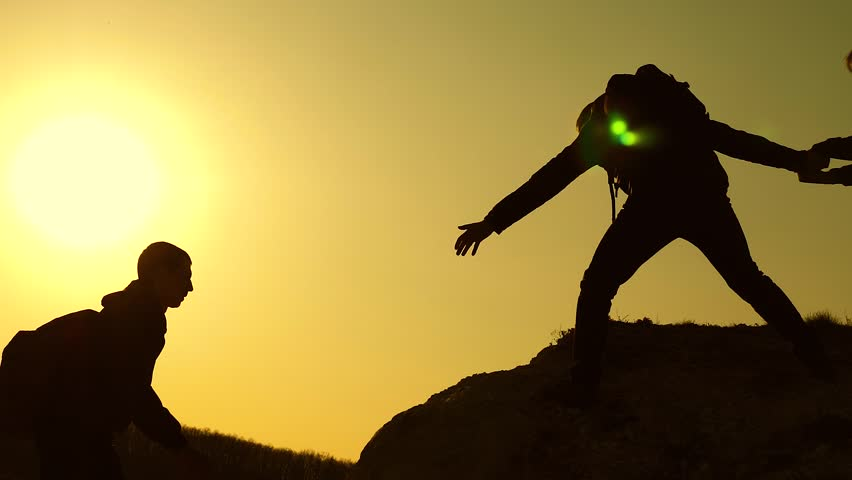 Collaboration climbers travelers at sunset. Silhouettes of men climbing to the top of the mountain. Travelers climb one by one on rocks. Joint business. Slow motion | Shutterstock HD Video #1029071306