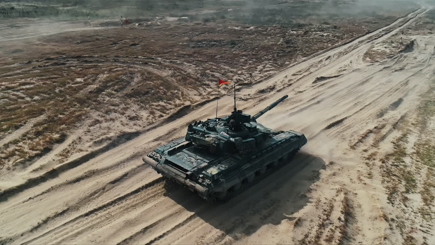 Military Army Tank Shooting Aerial View. Back View Armoured Combat Fighting Vechicle Shooting in Sand. War Battle Technology Concept. Drone Shot Footage 4K (UHD)
