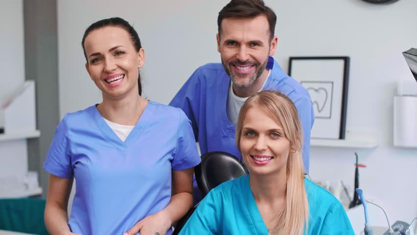 Portrait of three, smiling dentists in dentist's clinic Royalty-Free Stock Footage #1029096446