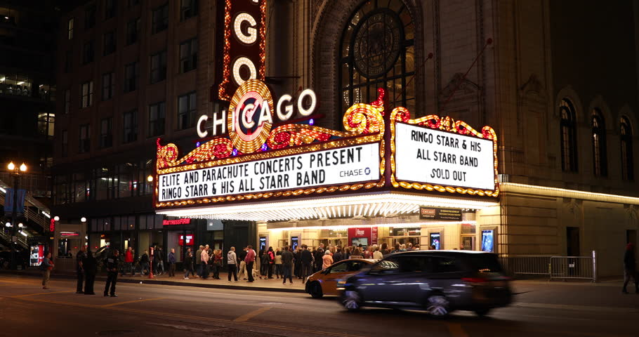 Chicago, Illinois, USA - September 24, 2018: People and traffic gather by the Chicago Theatre on North State Street in the Loop area of Chicago, Illinois USA.