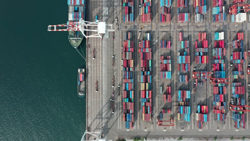 Logistic business or transport concept : Aerial top down view over import export port of Thailand with many stacks of cargo container rows and big cranes. | Shutterstock HD Video #1029115697