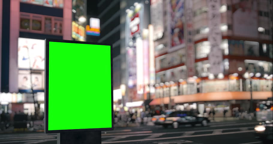 Modern billboard with a green screen, on the blurred megapolis background, neon street lights at night, traffic, Tokyo, Japan | Shutterstock HD Video #1029131699