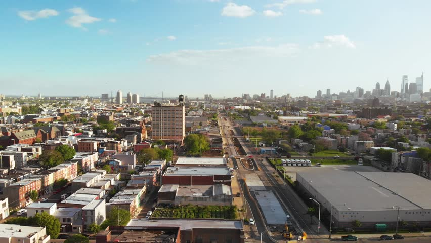 Aerial view of water tank on building in Philadelphia skyline 4K | Shutterstock HD Video #1029139994