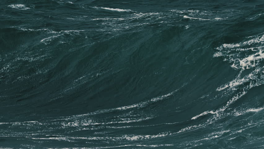 Large foamy wave barrelling onto a shallow reef. Slow motion. Royalty-Free Stock Footage #1029164897