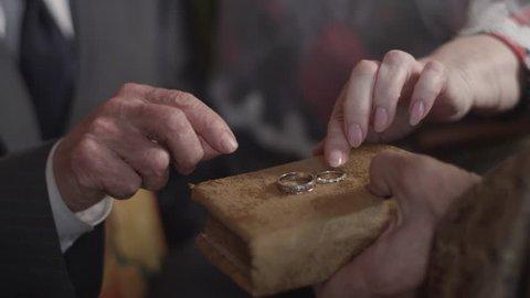 Priest marries an elderly couple wedding rings