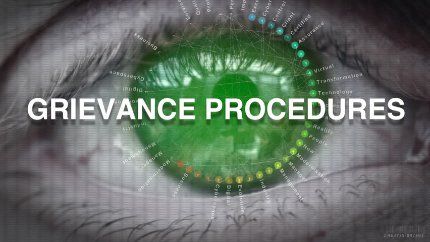 Close up of an eye focusing on a Grievance Procedures concept on a futuristic screen.