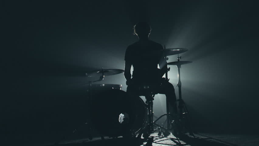 Male Drummer Silhouette Playing the Drums. Empty stage and concert lighting with smoke. | Shutterstock HD Video #1029219146