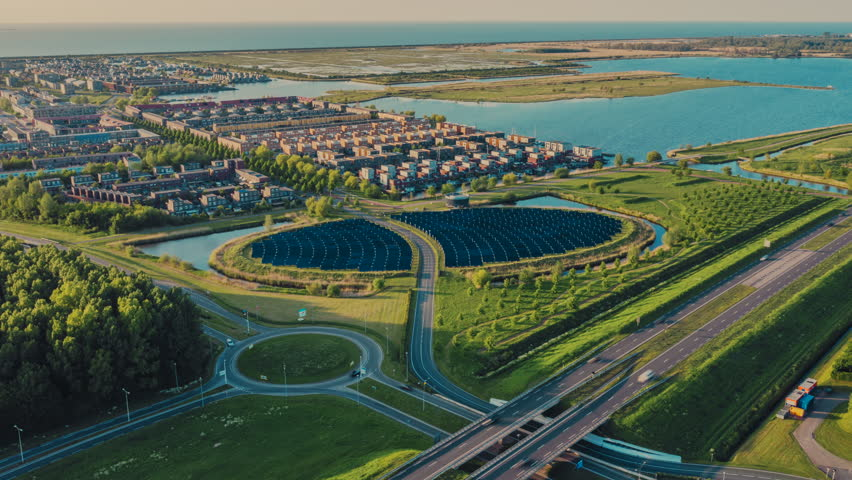 Aerial hyperlapse of modern sustainable residential neighbourhood in Almere, The Netherlands, with solar panels island providing city heating Royalty-Free Stock Footage #1029282791
