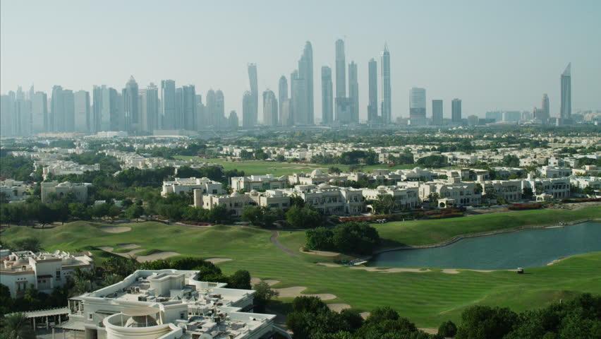 Aerial Dubai luxury homes Emirates Hills Golf Persian Gulf UAE | Shutterstock HD Video #10293278