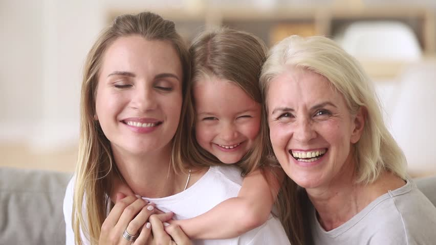 European family 3 generations mother little daughter aged grandmother portrait, close up faces happy laughing relative people pretty women at home, have fun, spend time together care and love concept