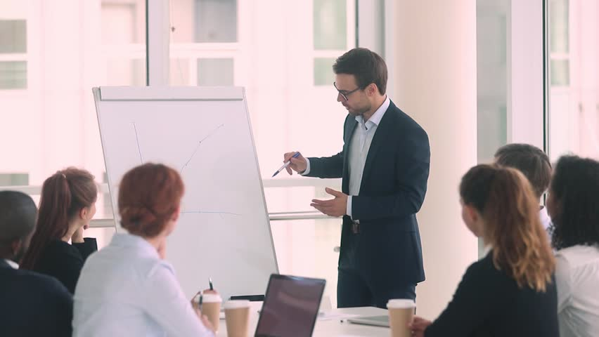 Businessman company representative present to client investors positive increasing sales shown on line graph on flip chart, business coach teaching multi-ethnic trainees during lecture seminar concept Royalty-Free Stock Footage #1029333359