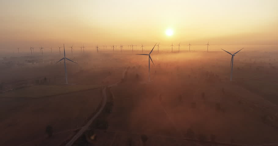 4k Aerial view of wind turbine sunrise in forested with fog . Sustainable development, environment friendly, renewable energy concept. | Shutterstock HD Video #1029334043