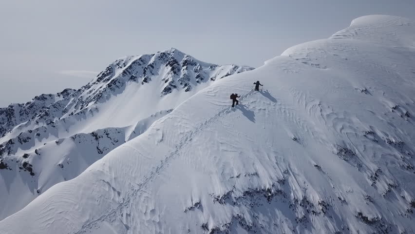 Climbers Walking Up Mountain Expedition Aerial Flight Epic Mountain Range Climb To Success Beautiful Peak Winter Vacation Exploration Adventure Hiking Tourism Concept.