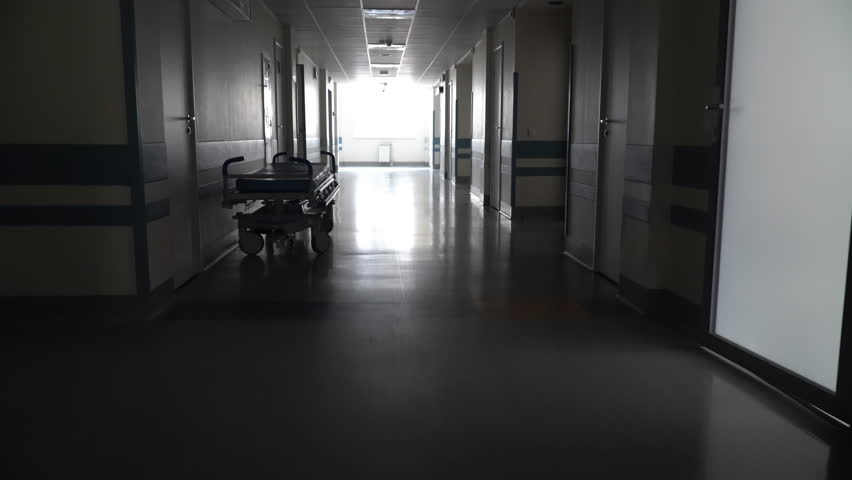 Dark Long Hallway with the Medical Gurney in the Hospital | Shutterstock HD Video #1029349565