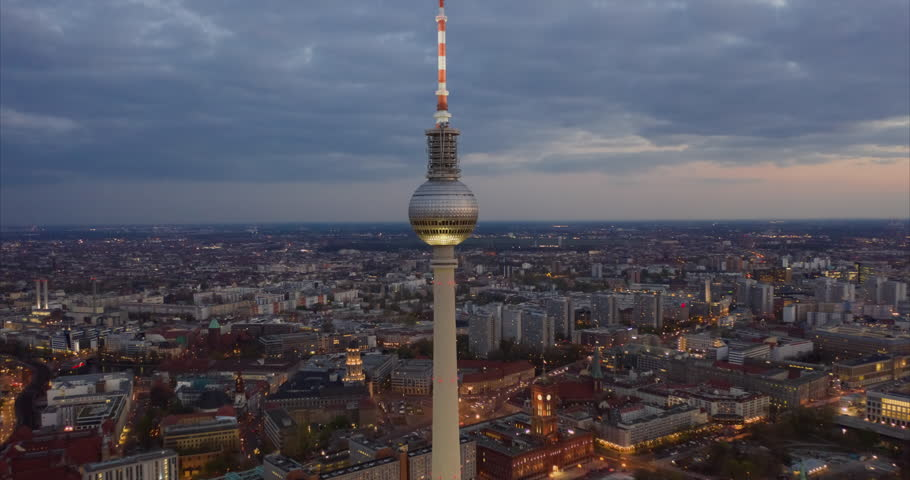 AERIAL: Day to Night Hyperlapse / Motion Timelapse of Berlin with Alexanderplatz TV Tower view and beautiful city lights 4k