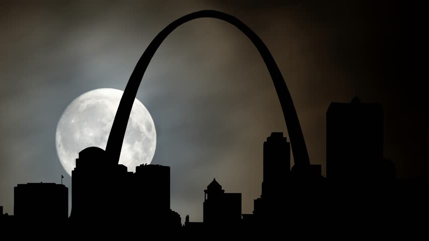 St. Louis Cityscape by Night with Full Moon, Clouds, Skyscrapers and Iconic Gateway Arch in Time Lapse, Missouri, USA