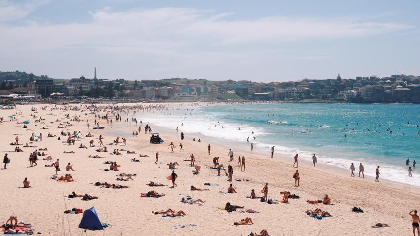 People relaxing and sunbathing at Bondi beach in Sydney, Australia | Shutterstock HD Video #1029385730