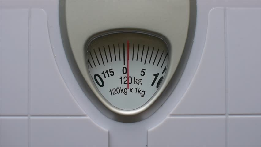 Close up body weight scales for measure weight loss.Weighing scale to healthy slimming concept.