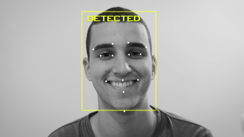 Man has his face and emotion detected by artificial intelligence as happy - computer learning mechanism and digital face recognition identity biometric scan predict human emotional current state