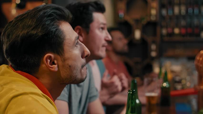 Men cheering their team in the pub   Shutterstock HD Video #1029467753