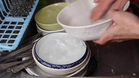 Many dishes are being washed.