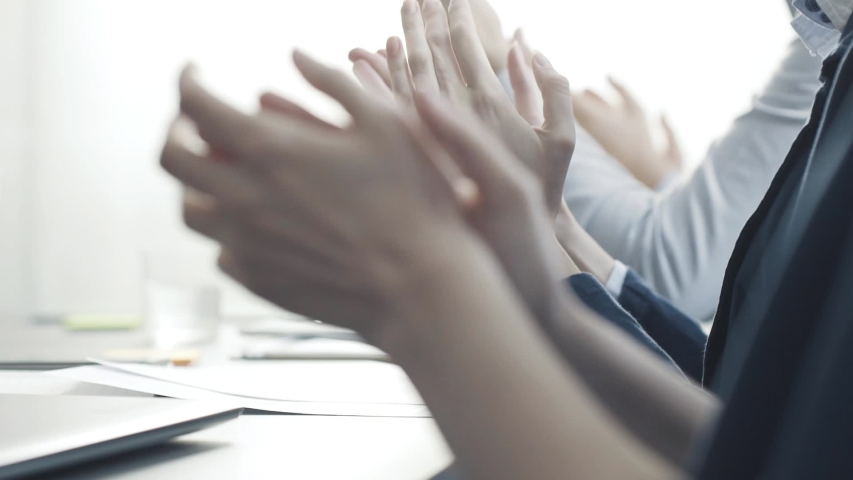 Cheerful successful business team applauding together and smiling, achievement and teamwork concept | Shutterstock HD Video #1029501287