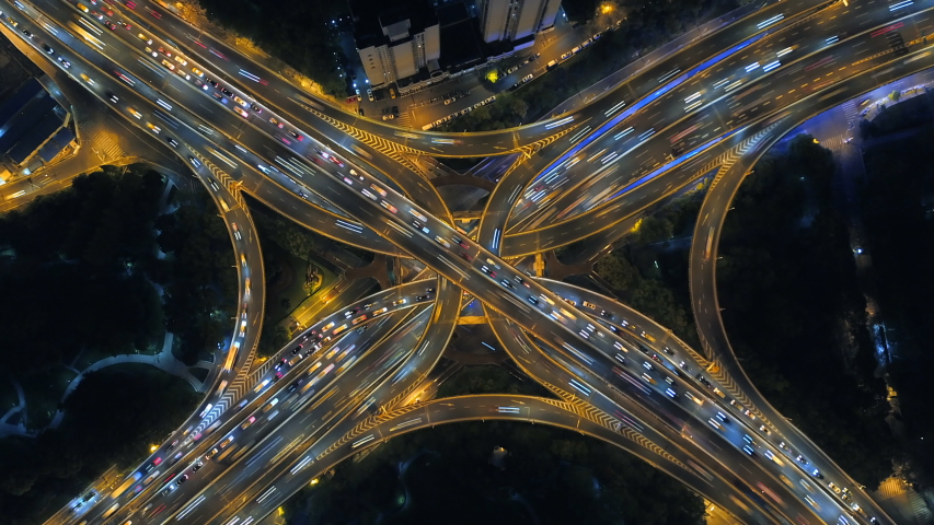 Time lapse of aerial view of highway junctions shape letter x cross at night. Bridges, roads, or streets in connection or transportation concept in urban city, Shanghai Downtown, China. #1029514577