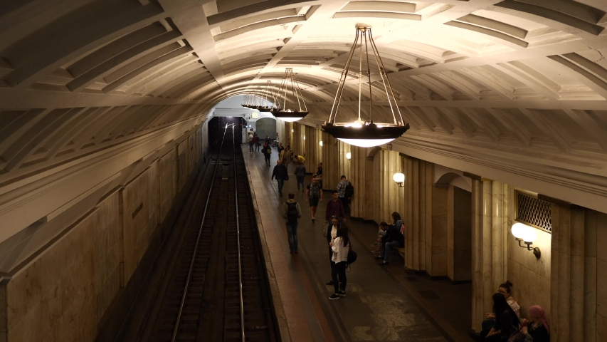 MOSCOW - MAY, 2018: People and train arriving inside Kurskaya subway station. One of the most famous Metro stations in the world. The Moscow subway opened in 1938.