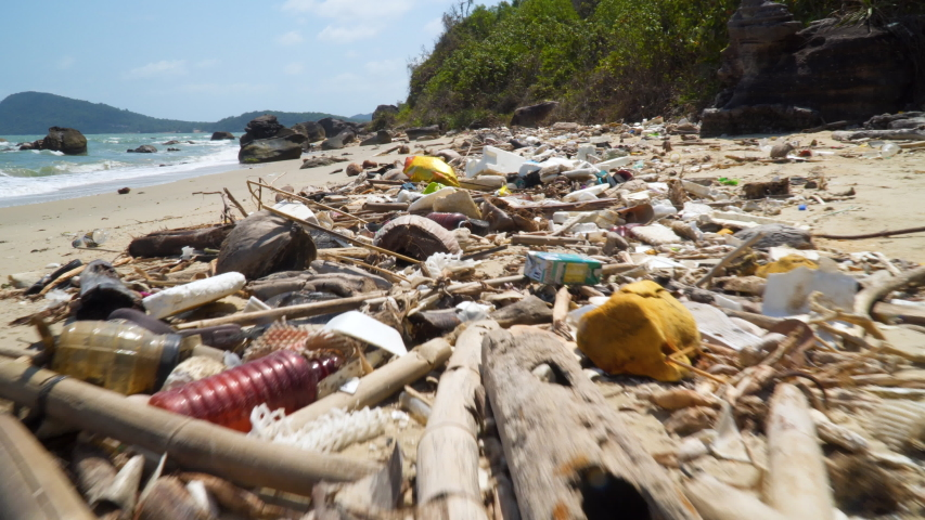 Large amount of plastic trash littering the ocean shore. Concept of Ocean Rubbish And Pollution Environmental problem | Shutterstock HD Video #1029548930