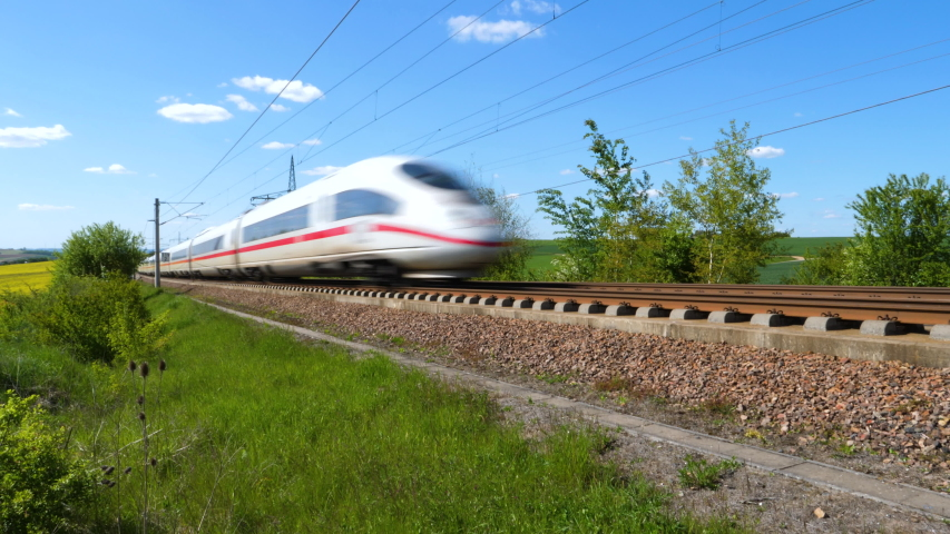 Dauborn, Germany - May 15, 2019: Tracking shot of a passing ICE train on the highspeed line Frankfurt - Cologne near Limburg. ICE is a highspeed train system in Germany